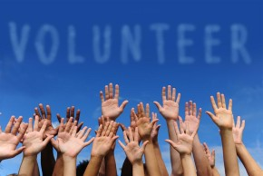 bigstock_volunteer_group_raising_hands__19543958